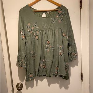 Green blouse with floral print